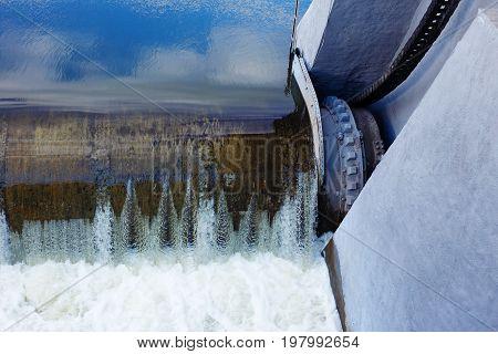 Water Rushing Through Gates At A Dam
