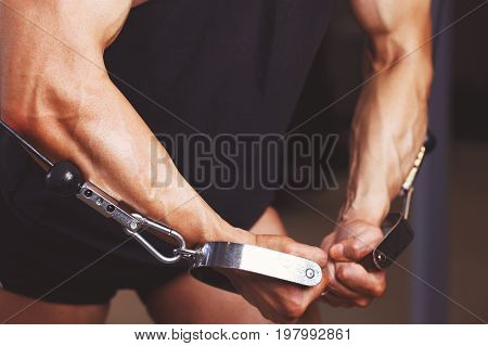 Strong Ripped Tense Man Hands Working Out In Gym Close Up.