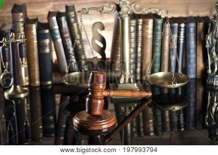 Law theme. Mallet of the judge in the court library.