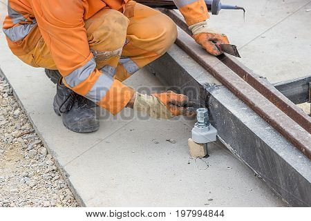 Man Applying Silicone Sealant With Putty Knife