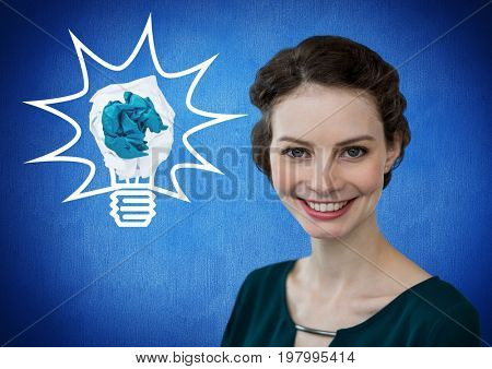 Digital composite of Woman standing next to light bulb with crumpled paper ball