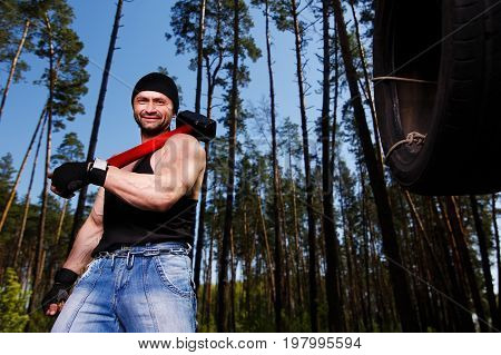 Strong Healthy Adult Ripped Man With Big Muscles Working Out Wit