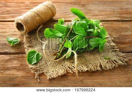 Lemon balm with twine on wooden table