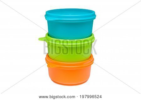 Three plastic food bowls with lids stacked on each other isolated on white background