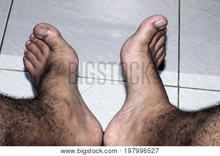 barefoot feet floor person relax people male