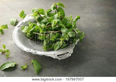 Metal tray with lemon balm on table