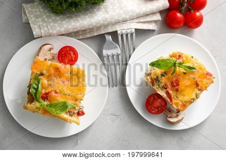 Two plates with delicious turkey casserole on table