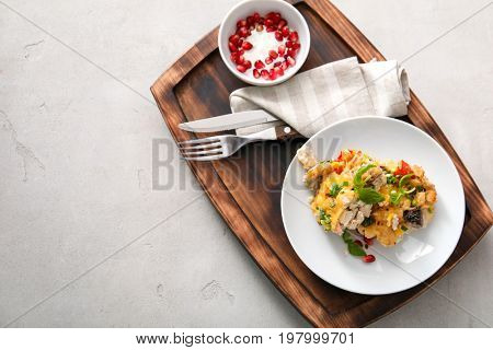 Composition with delicious turkey casserole on table