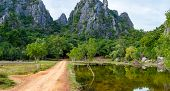 The dirt road to Khao Dang Viewpoint Sam Roi Yod National park Phra Chaup Khi Ri Khun Province in Middle of Thailand. Day view. poster