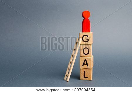 The Red Figure Of A Man Stands On A Tower Of Cubes With The Word Goal. Leadership Skills. The Concep