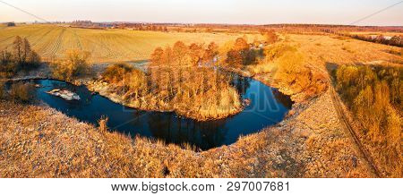 Bright Sunrise Over Wild Curved River Aerial View.