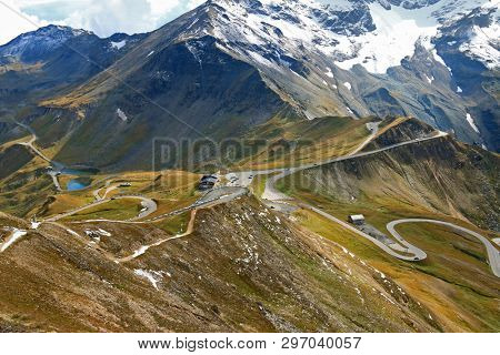 View of the Fuscher lake and Grossglockner High Alpine Road (Hochalpenstrasse). The windy road with 36 bends that leads to the heart of the Hohe Tauern National Park in Austria.  poster
