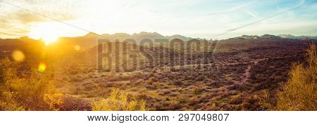 A panorama over the vast Sonoran Desert of Arizona during sunset with mountains in the background and natural vegetation in the for foreground. poster