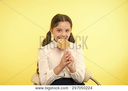 Lollipop Child. Child Eating Lollipop In Yellow Studio. Lollipop Child Eating Candy With Happy Face.