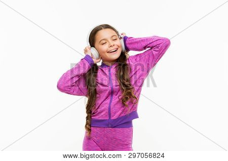 What A Great Feeling. Athletic Little Girl Relaxing Isolated On White. Cute Girl Child Listening To