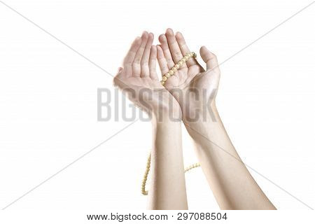 Muslim Hands Praying With Prayer Beads Isolated Over White Background