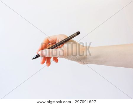 Young Woman Hand Isolated On White. Female Hand Is Ready For Drawing With Black Pen. Isolated On Whi