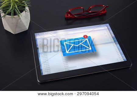 E-mail Marketing Concept. New Email Notification On Tablet Computer.