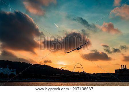 Barceloneta Beach In Barcelona With Colorful Sky At Sunrise.