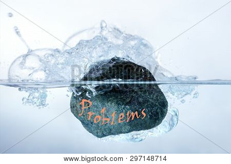 Concept Solution To The Problem, Puzzle, Difficulty. Man Throws A Stone Of Problems In The Water.