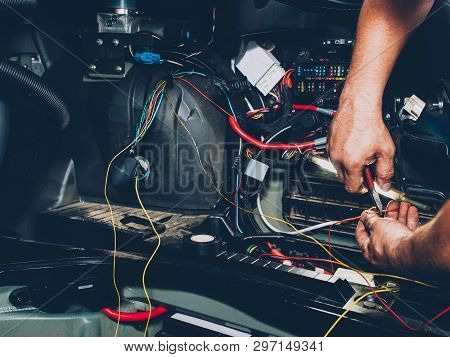 Mechanic Electrician Checking Repairing Upgrading Wiring. Auto Service Workshop. Regular Preventive