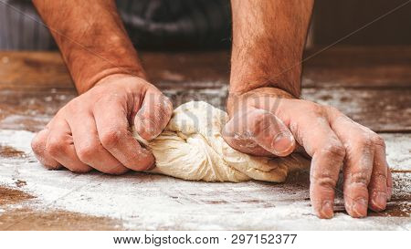 Bread Making Process. Closeup Of Man Hands Kneading Dough. Baker Cooking Pastry. Culinary Courses An