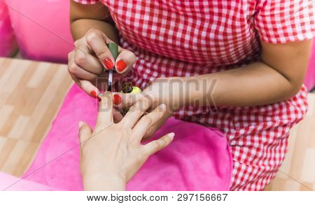 Close Up Of Female Applying Transparent Nail Polish
