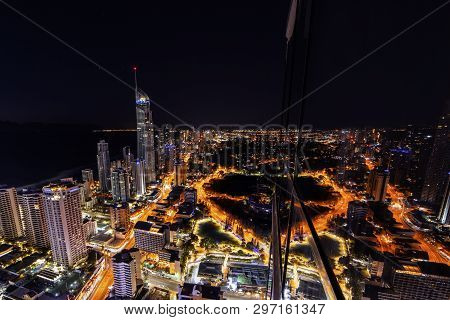 Gold Coast, Australia - April 7 2019: Surfers Paradise Aerial Nightscape Window Mirror Reflections