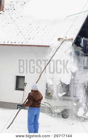 Cleaning snow off the roof