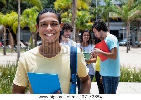 Happy Egyptian Scholarship Student With Group Of International Students Outdoor On Campus Of Univers