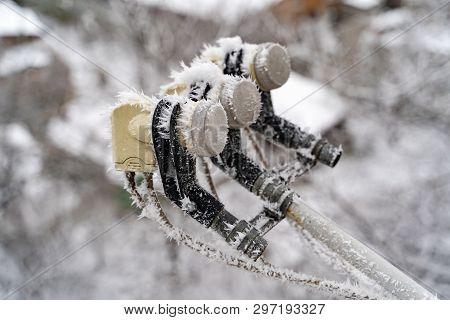Frostbitten Satellite Dish. Satellite Dish In The Snow On Background Urban View