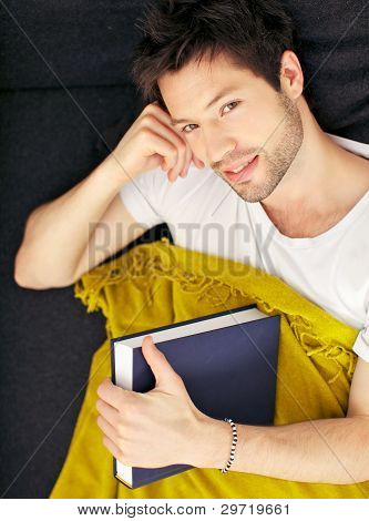Tired Student With Blanket And Textbook