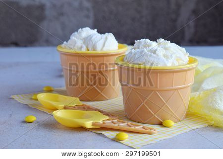 Homemade Vanilla Ice Cream On Marble Background. White Frozen Delicious Dessert In Individual Glass