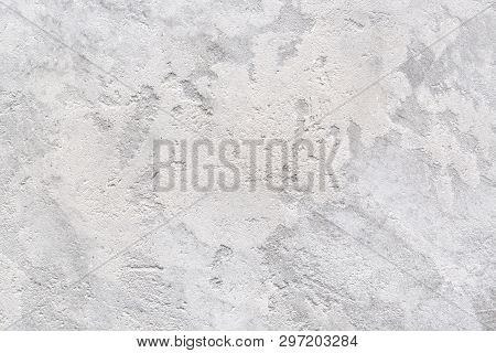 Patchy Gray Texture Of Rough Concrete Wall Or Abstract Plaster Pattern. Light Gray Background. Moder