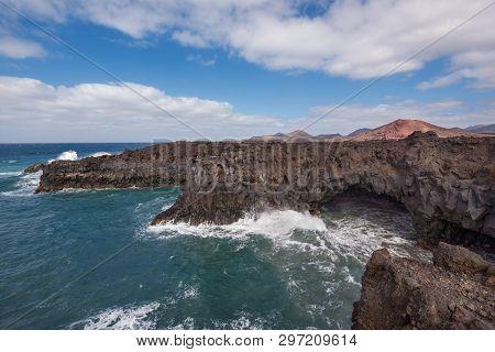 Lanzarote landscape. Los Hervideros coastline, lava caves, cliffs and wavy ocean. No people appears in the scene. poster