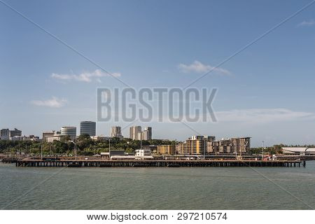 Darwin Australia - February 22, 2019: Darwin Skyline Seen From South Upon Harbour Bay Water Under Bl