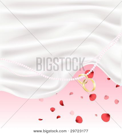 silk, red petals and two golden rings