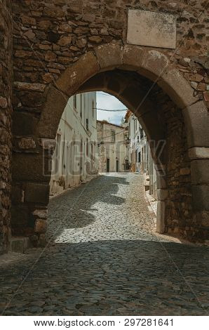 Gothic Arched Door In The Stone Outer Wall Called Sun Gateway, In A Cloudy Day At The Castle Of Estr