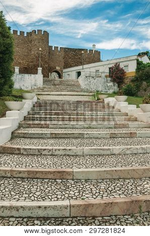 Cobblestone Stairway Up The Hill Towards The Gothic Castle In A Cloudy Day At Estremoz. A Nice Littl