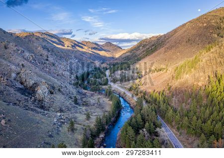 sunset and moon rise over mountain river canyon - Poudre River in northern Colorado aerial view in early spring