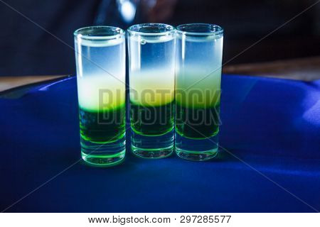 layer alcohol drink on bar. cocktail