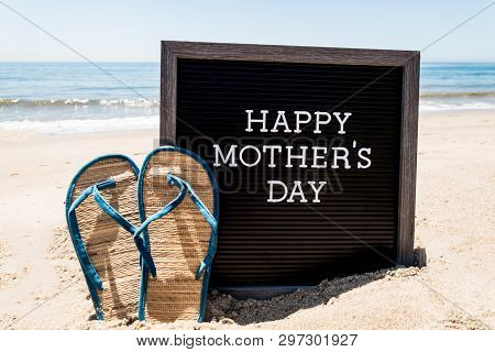 Happy Mothers Day Beach Background With Black Board And Flip Flops