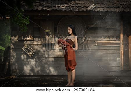 Woman Ghost Drama And Carrying Her Baby Ghost Standing On Old Thai House / Horror Legend Of Mae Nak