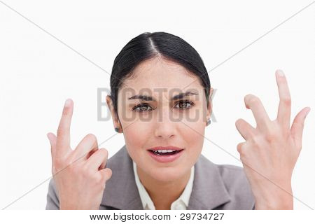 Close up of confused looking businesswoman against a white background
