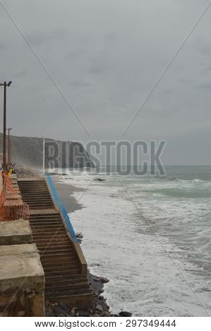 Entrance Stairs To The Beach On A Cloudy Day At Playa Grande In Colares. Nature, Architecture, Histo