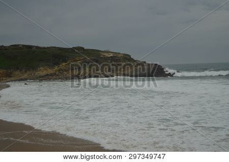 Wonderful Cliff On A Cloudy Day On Big Beach In Colares. Nature, Architecture, History, Street Photo