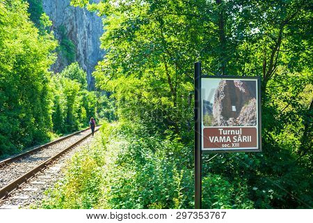Bihor, Romania - June 24, 2017: Vama Sarii Signpost And Railroad With Narrow Path Alongside It, Prov