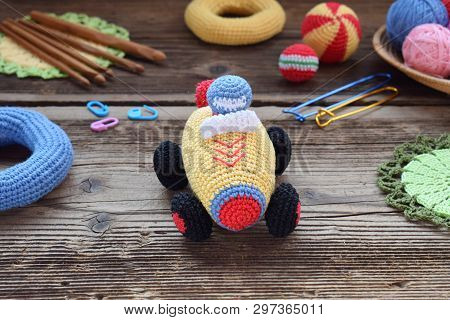 Making Colored Crochet Racing Car. Toy For Babies And Toddlers To Learn Mechanical Skills And Colors