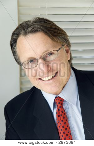 A Happy Smiling Businessman Wearing Spectacles.