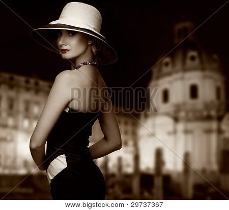 Retro woman against night city.
